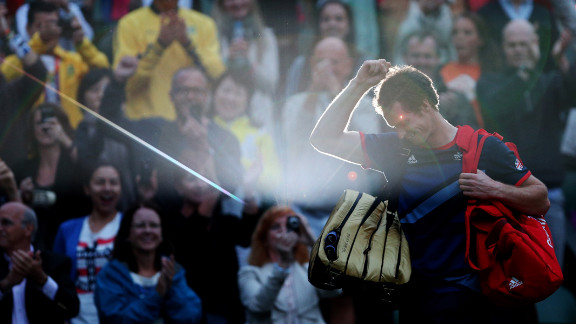 Andy Murray of Great Britain celebrates his 7-5, 7-5 win against Novak Djokovic of Serbia in the semifinal of men