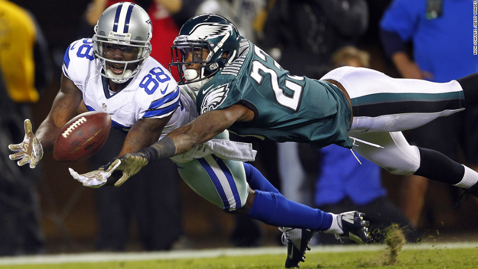 Dez Bryant of the Dallas Cowboys dives to makes a catch for a 30-yard touchdown as Dominique Rodgers-Cromartie of the Philadelphia Eagles defends on November 11 in Philadelphia. The Cowboys defeated the Eagles 38-23.