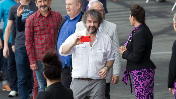 """""""Hobbit"""" director Peter Jackson (c), pictured here at Wellington airport, has filmed a number of blockbusters in his native New Zealand."""