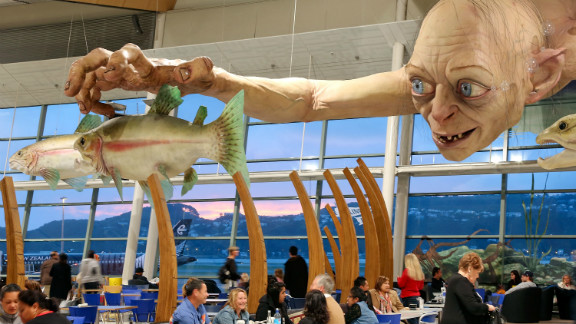 """A giant sculpture of """"Gollum"""" dominates Wellington Airport -- city officials expect 100,000 people to take to the streets of the city for Wednesday's premiere."""
