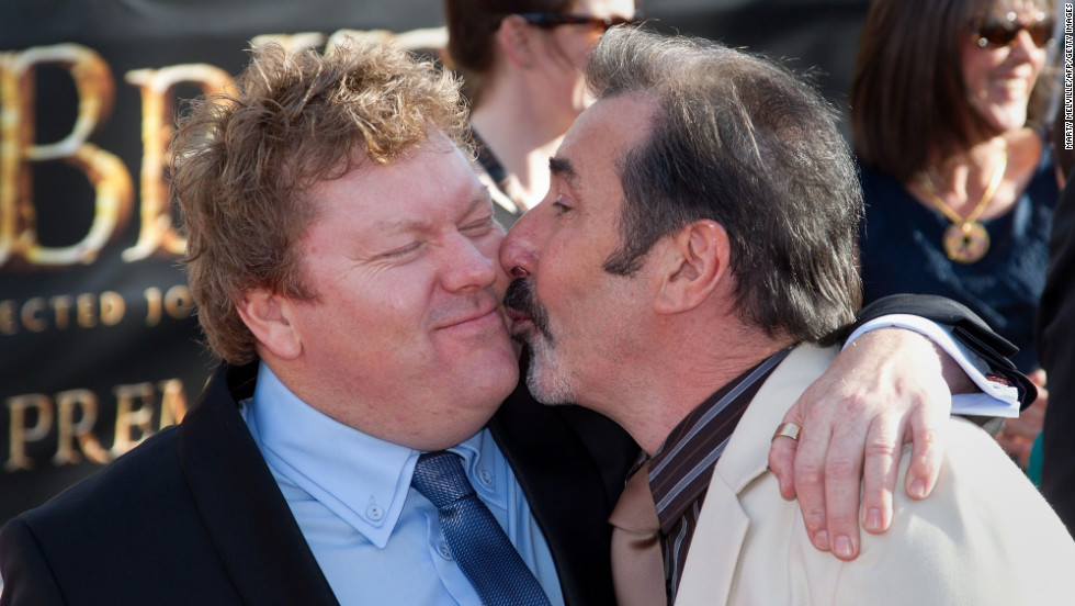 Actor Stephen Hunter, left, receives a kiss from actor William Kircher on the red carpet of the world premiere.