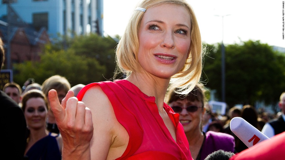 Actress Cate Blanchett speaks to reporters upon her arrival.