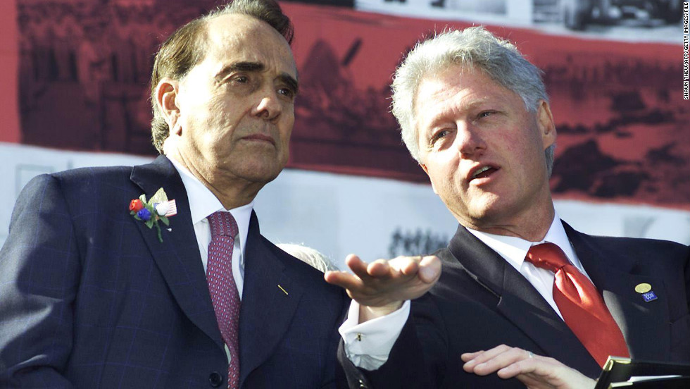 President Bill Clinton talks with former Sen. Bob Dole, his presidential rival four years earlier, before making remarks at the WWII Memorial groundbreaking ceremony in Washington on October 11, 2000.
