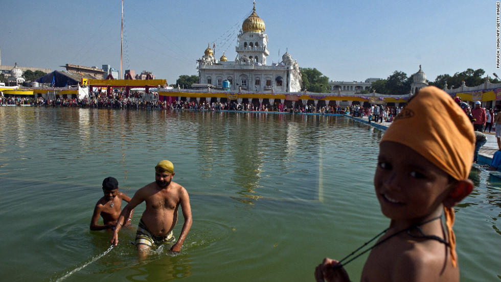 An Indian Sikh devotee takes a dip in the sarovar at the Bangla Sahib Gurudwara in New Delhi on the anniversary.