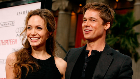 """Pitt and Jolie quickly became a fixture on the red carpet and in celebrity gossip magazines as they continued to grow their family. Seen here, the pair arrive at the June 2007 premiere of Pitt's """"Ocean's Thirteen."""""""