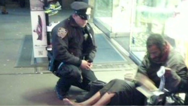 point NYPD deprimo boots for homeless man_00013116