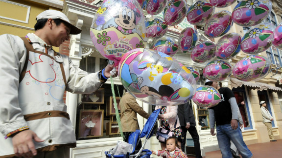 File photo of a balloon seller at the Tokyo Disneyland greeting visitors in 2011.