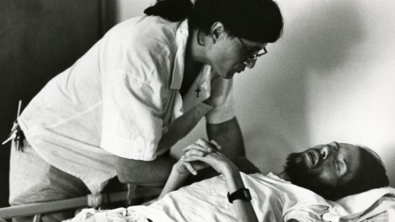 Peta, a volunteer at Pater Noster House, cares for Kirby. After Kirby's death in April 1990, Frare began photographing Peta, another AIDS patient.