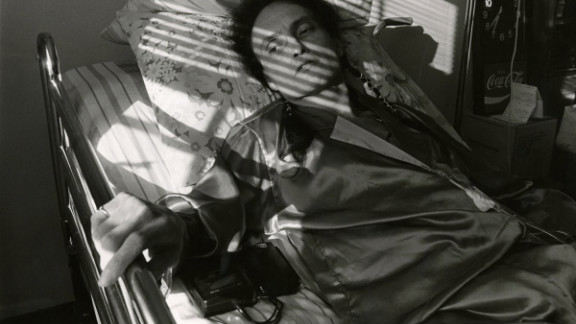 """Peta lays in a bed at Pater Noster House in 1992. See the full gallery at <a href=""""http://life.time.com/history/behind-the-picture-the-photo-that-changed-the-face-of-aids/?iid=lb-gal-viewagn#1"""" target=""""_blank"""" target=""""_blank"""">Life.com</a>."""