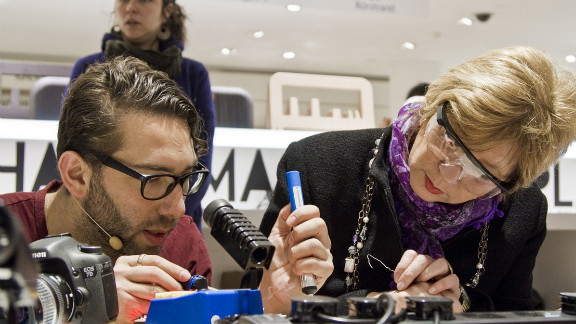 In this picture, TWSU co-founder Daniel Hirschmann teaches a workshop attendee how to solder.