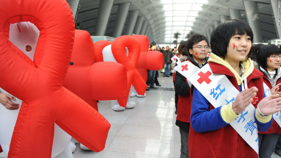 Volunteers from Red Cross China take part in an AIDS-awareness event on World AIDS Day in Beijing on December 1, 2009.