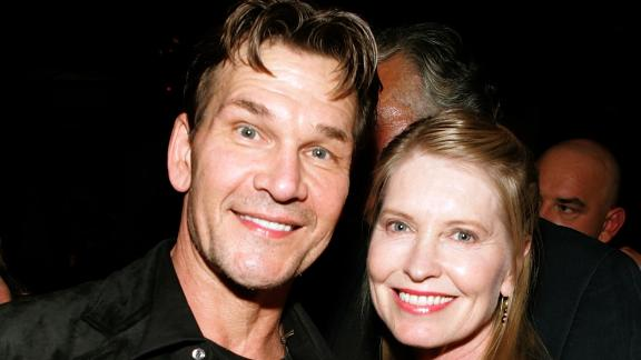 Patrick Swayze and wife Lisa Niemi, pose at the premiere of MGM