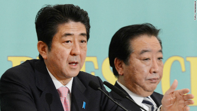 PM Yoshihiko Noda and former PM Shinzo Abe during a general election debate November 30.