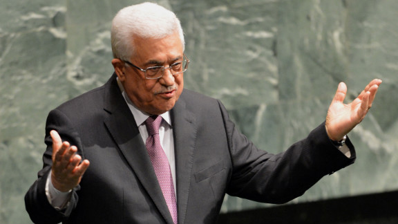 Mahmoud Abbas gestures to members at the General Assembly after speaking.