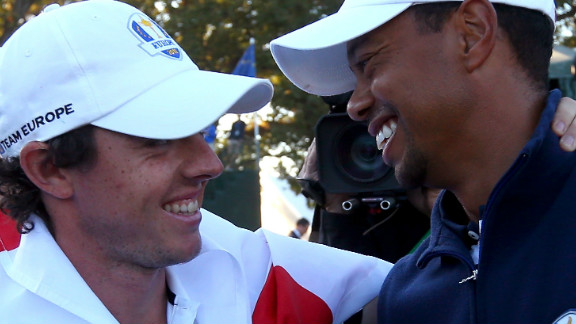 Tiger Woods, right, congratulates Rory McIlroy after Europe