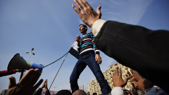 An Egyptian man delivers a speech as protesters gather in Cairo