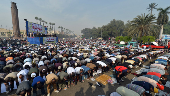 Thousands pray during a rally in support of Morsy in front of Cairo University on December 1.