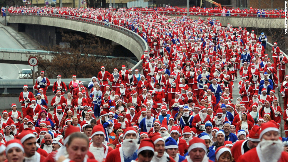 Runners dressed in Father Christmas costumes take part in the annual 5-kilometer Santa Dash  sc 1 st  CNN.com : santa crawl costume ideas  - Germanpascual.Com