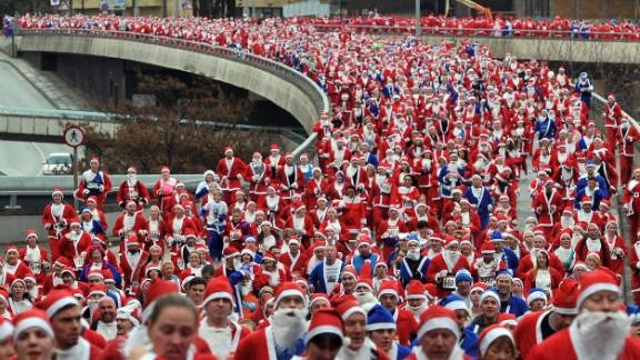 Runners dressed in Father Christmas costumes take part in the annual 5-kilometer Santa Dash in Liverpool, England, on Sunday, December 2. Many runners who refuse to run in red, the color of their football rivals Liverpool FC, wear blue to support the football team Everton FC.