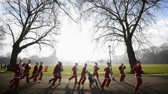 Competitors run in the annual 6-kilometer Santa Run in Battersea Park, London, on December 1.