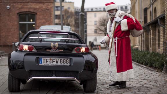 A man dressed as Santa leaves the the annual meeting of volunteer Santa Clauses and angels on December 1 in Berlin. Studentenwerk Berlin, a student organization at the German capital