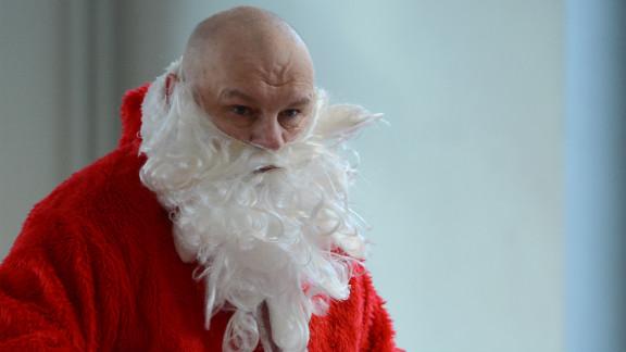 A man dressed as Santa Claus attends Berlin