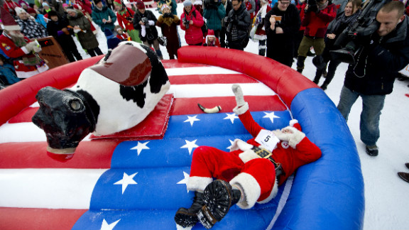 """Japanese Santa Claus """"Santa Paradise Yamamoto"""" hits the ground in the reindeer ride event during the competition in Gallivare on November 17. Related photos: Magnum Santas"""