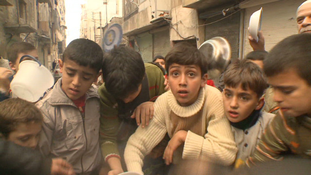 Children fight for food in Aleppo