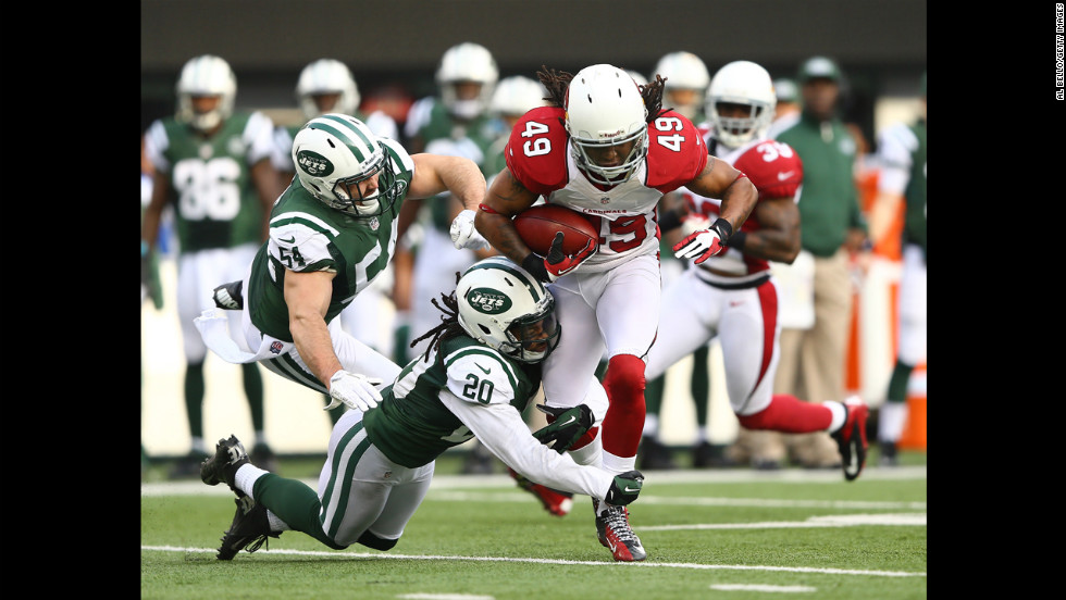 Rashad Johnson of the Arizona Cardinals gets a first down on a fake punt as Kyle Wilson of the New York Jets makes the tackle on December 2 at MetLife Stadium in East Rutherford, New Jersey.