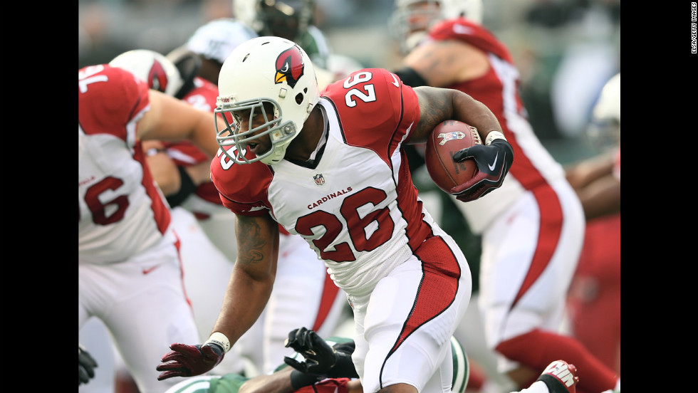 Beanie Wells of the Arizona Cardinals carries the ball in the first quarter on Sunday  against the New York Jets.