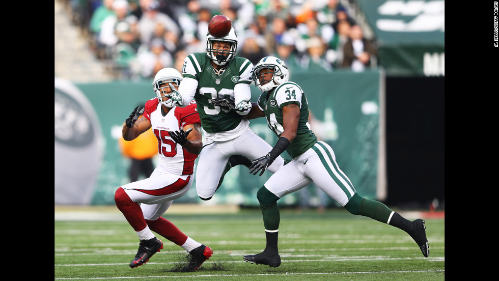LaRon Landry of the New York Jets intercepts a pass on Sunday.