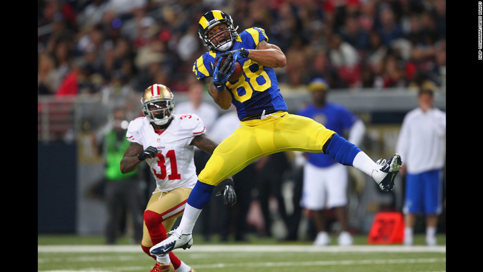 Lance Kendricks of the St. Louis Rams catches a pass against Donte Whitner of the San Francisco 49ers on Sunday at the Edward Jones Dome in St. Louis.