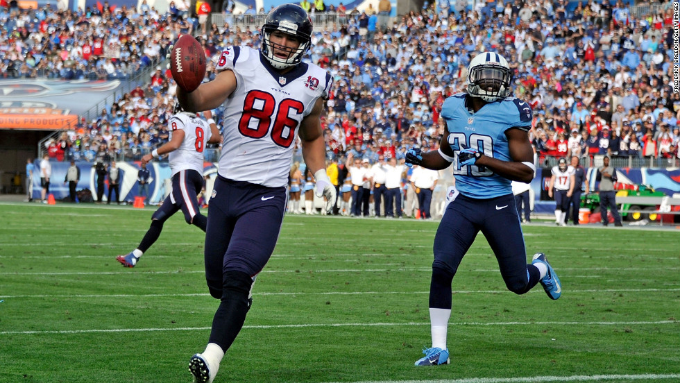 Ryan Mouton of the Tennessee Titans pursues James Casey of the Houston Texans as he enters the end zone on Sunday.