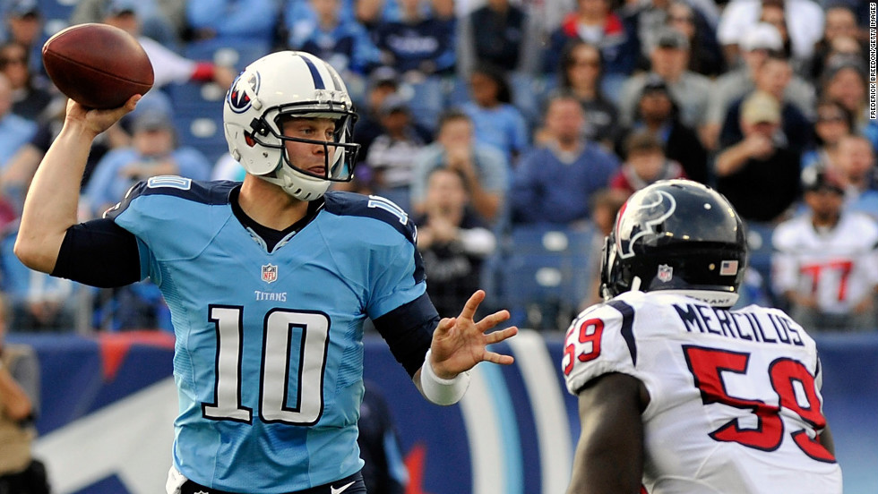 Quarterback Jake Locker of the Tennessee Titans drops back to pass over Whitney Mercilus of the Houston Texans on Sunday.