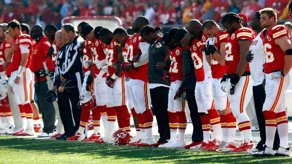 Before their game against the Carolina Pathers, the Kansas City Chiefs pause for a moment of silence.
