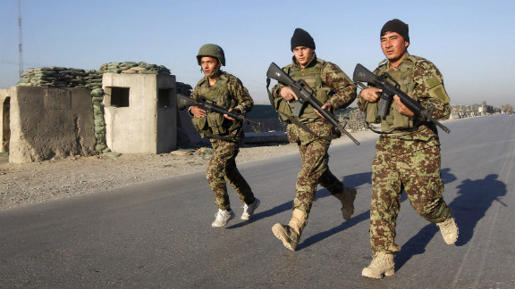 Afghan National Army soldiers arrive in Jalalabad after suicide attackers detonated bombs outside a U.S. base in Afghanistan.