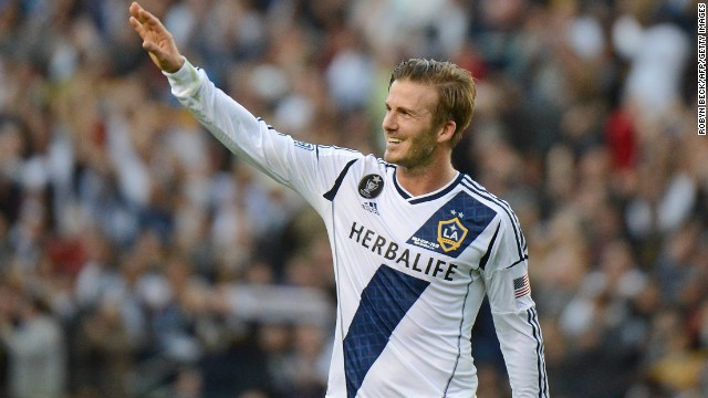 David Beckham waves to fans as he walks off the pitch after the Los Angeles Galaxy defeat the Huston Dynamo in the 2012 MLS Cup.