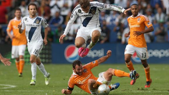 Beckham leaps over Houston