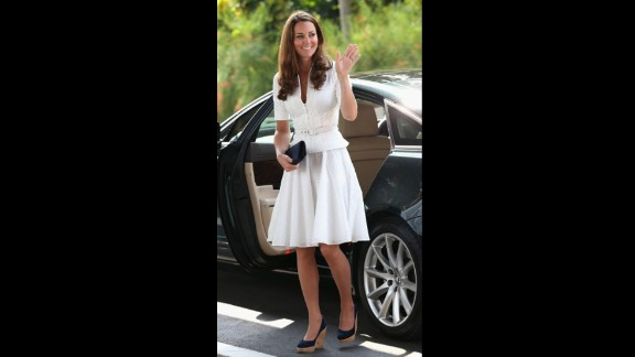 Wearing a white suit by Alexander McQueen, the Duchess of Cambridge arrived at Singapore