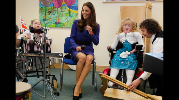 Catherine joins in a music class during a visit to The Treehouse in Ipswich, eastern England, on March 19, 2012. Her visited marked the formal opening of The Treehouse, a children