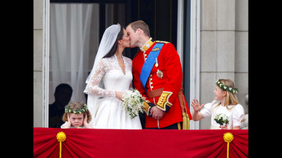 Prince William and Kate kiss on the balcony of Buckingham Palace in London after their wedding at Westminster Abbey on April 29, 2011. Two young bridesmaids, Grace Van Cutsem, left, and Margarita Armstrong-Jones, right, seem to have differing views of being in the public eye.