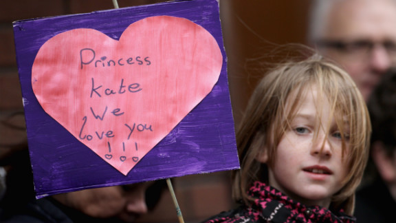 A young child holds up a banner as Catherine visits Alder Hey Children
