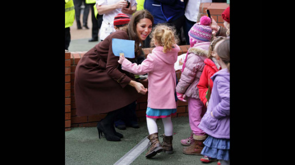 Catherine greets a young girl during a walkabout as she visits Alder Hey Children