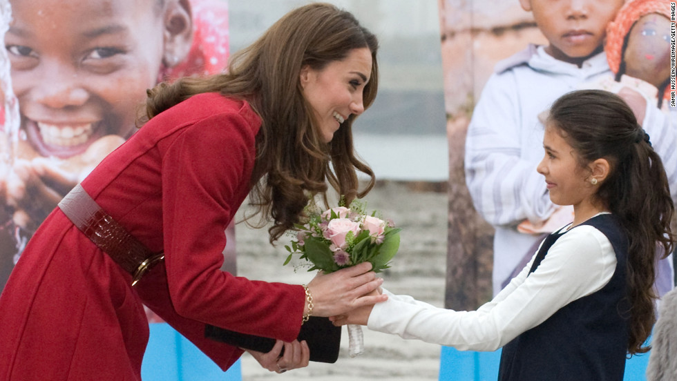 Catherine receives a bouquet of flowers from a young girl during her visit to the UNICEF Centre on November 2, 2011, in Copenhagen, Denmark.