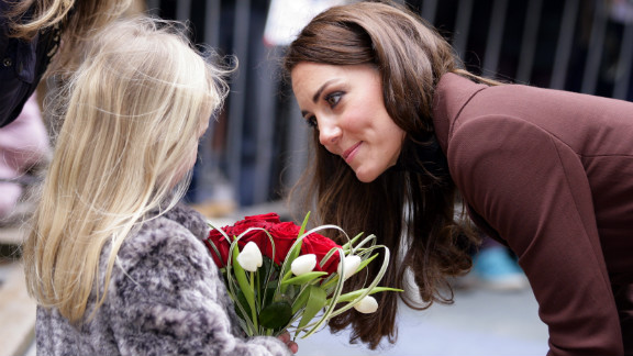 Catherine talks with a young girl as she arrives for a visit to Alder Hey Children