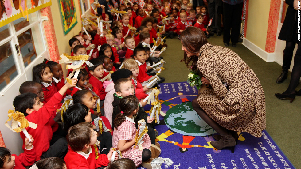 Catherine, right, speaks with schoolchildren during an official visit to the Art Room facilities at Rose Hill Primary School in Oxford on February 21, 2012.