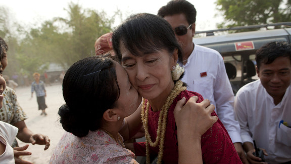 April 1: A supporter kisses Aung San Suu Kyi, leader of the National League for Democracy, as she visits polling stations in her constituency as Burmese vote in parliamentary elections in Kawhmu, Myanmar. She won a seat in parliament in Myanmar