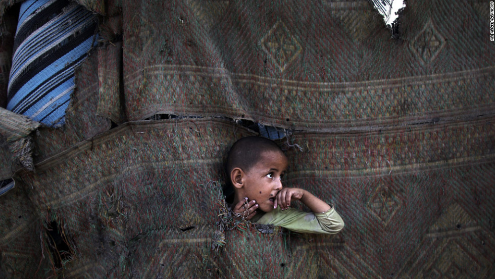 <strong>July 22:</strong> A Palestinian refugee plays in between makeshift tents in the Al-Zaiton neighborhood before breaking fast on the third day of the holy month of Ramadan in Gaza. During Ramadan, Muslims fast from dawn to dusk.