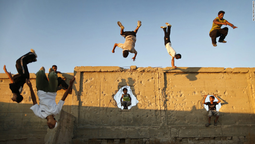 <strong>September 17: </strong>Palestinian youths practice their parkour skills in Khan Younis in southern Gaza. Parkour athletes run along a route, using obstacles to propel themselves. The practice originiated in France.