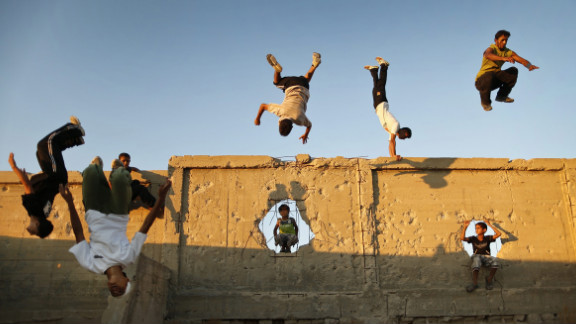 September 17: Palestinian youths practice their parkour skills in Khan Younis in southern Gaza. Parkour athletes run along a route, using obstacles to propel themselves. The practice originiated in France.